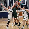 Elyria Catholic's Ally Winnen and Meghan Allegretto defend a shot by Strongsville's Marnae Holland during the first quarter of the Lorain County Holiday Classic Randy Meyers -- The Morning Journal