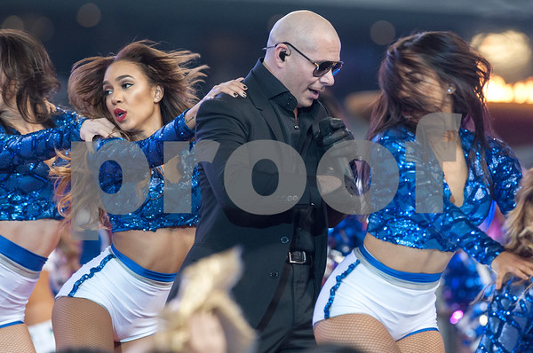 photo by Sarah A. Miller/ Tyler Morning Telegraph  Musical artist Pitbull performs during the halftime show at the Dallas Cowboys football game Thursday Nov. 27, 2014 at AT&T Stadium in Arlington.