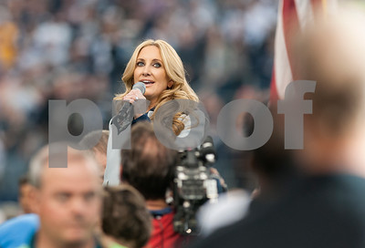 photo by Sarah A. Miller/ Tyler Morning Telegraph  Musical artist Lee Ann Womack sings the National Anthem at the Dallas Cowboys football game held on Thanksgiving Thursday Nov. 27, 2014 at AT&T Stadium in Arlington.