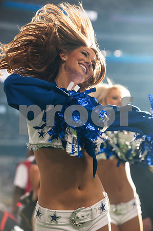 photo by Sarah A. Miller/ Tyler Morning Telegraph  The Dallas Cowboy cheerleaders perform on the sidelines during the Dallas Cowboys football game held on Thanksgiving Thursday Nov. 27, 2014 at AT&T Stadium in Arlington.