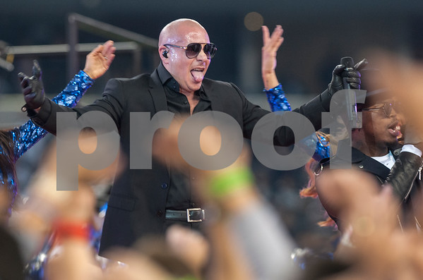 photo by Sarah A. Miller/ Tyler Morning Telegraph   Musical artist Pitbull performs with Ne-Yo during the halftime show at the Dallas Cowboys football game Thursday Nov. 27, 2014 at AT&T Stadium in Arlington.