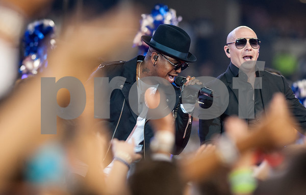 photo by Sarah A. Miller/ Tyler Morning Telegraph  Singers Ne-Yo, left, and Pitbull, right, perform during the halftime show at the Dallas Cowboys football game Thursday Nov. 27, 2014 at AT&T Stadium in Arlington.