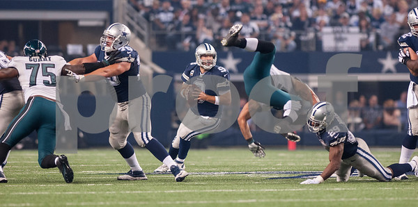 photo by Sarah A. Miller/ Tyler Morning Telegraph  Dallas Cowboy's quarterback Tony Romo looks to make a pass during their football game against the Philadelphia Eagles Thursday Nov. 27, 2014 at AT&T Stadium in Arlington. The Eagles beat the Cowboys 33-10.
