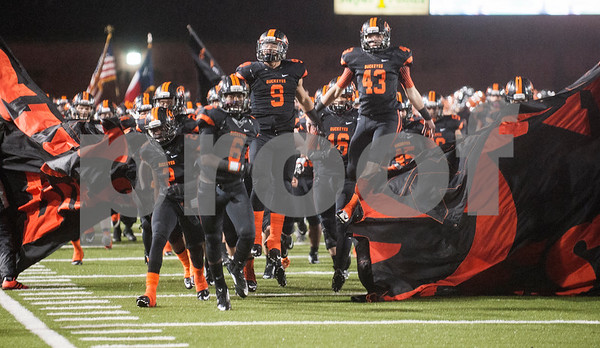 Gilmer football players take the field for their game Friday night against Center Nov. 27, 2015 at Trinity Mother Frances Rose Stadium in Tyler.  (Sarah A. Miller/Tyler Morning Telegraph)