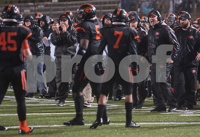 Gilmer's coaches instruct from the sidelines during their game against Center Friday night Nov. 27, 2015 at Trinity Mother Frances Rose Stadium in Tyler.  (Sarah A. Miller/Tyler Morning Telegraph)