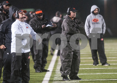 Gilmer's coach Matt Turner, center, watches from the  sidelines during their game against Center Friday night Nov. 27, 2015 at Trinity Mother Frances Rose Stadium in Tyler.  (Sarah A. Miller/Tyler Morning Telegraph)