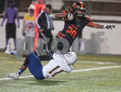 Gilmer's (20) Cambron Granville is brought down in the end zone by Center's (11) Devin Randle, scoring a touchdown in the first quarter of their game Friday night Nov. 27, 2015 at Trinity Mother Frances Rose Stadium in Tyler.  (Sarah A. Miller/Tyler Morning Telegraph)