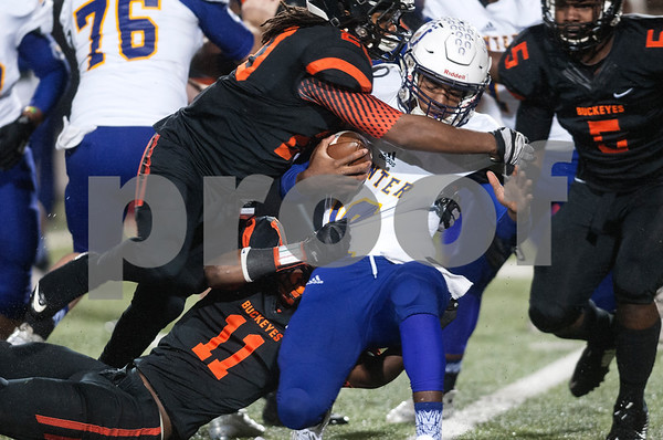 Gilmer's (20) Cambron Granville and (11) Preston Smith tackle Center's (10) Kyle Parks Friday night Nov. 27, 2015 at Trinity Mother Frances Rose Stadium in Tyler.  (Sarah A. Miller/Tyler Morning Telegraph)