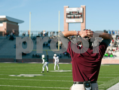 photo by Sarah A. Miller/Tyler Morning Telegraph  Whitehouse coach Jason Chuck looks at the scoreboard after Mesquite Poteet scores during their game Friday afternoon at Eagle Stadium in Allen. Poteet won, 65-60.