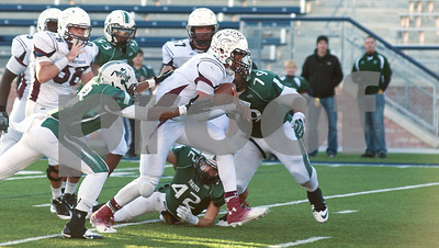 photo by Sarah A. Miller/Tyler Morning Telegraph   Mesquite Poteet's (8) Malachi Cobb reaches forward to stop Whitehouse's Patrick Mahomes as Mahomes comes close to the end zone during their game Friday afternoon at Eagle Stadium in Allen. Poteet won, 65-60.