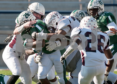 photo by Sarah A. Miller/Tyler Morning Telegraph  A group of Whitehouse defenders including (49) Dillan Klein, at left, stop Mesquite Poteet's (26) Marquise Banks during their game Friday afternoon at Eagle Stadium in Allen. Poteet beat Whitehouse, 65-60.