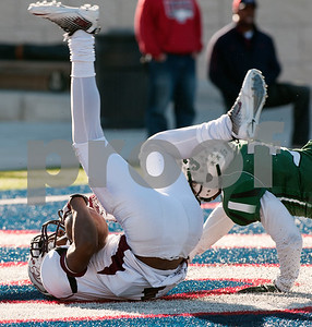photo by Sarah A. Miller/Tyler Morning Telegraph   Whitehouse's Jaylon Dews lands upside down in the end zone scoring a touch down during their game Friday afternoon at Eagle Stadium in Allen. Poteet won, 65-60.