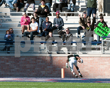 photo by Sarah A. Miller/Tyler Morning Telegraph  Mesquite Poteet's (81) Kody Edwards tumbles into the end zone scoring a touch down during their game Friday afternoon at Eagle Stadium in Allen. Poteet beat Whitehouse, 65-60.