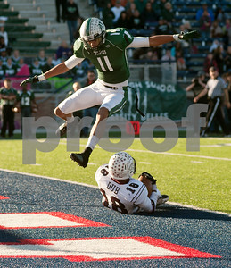 photo by Sarah A. Miller/Tyler Morning Telegraph  Mesquite Poteet's (11) Nate Gaines jumps over Whitehouse's (18) Dee Johnson as Johnson makes a touchdown in the end zone during their game Friday afternoon at Eagle Stadium in Allen. Poteet won, 65-60.