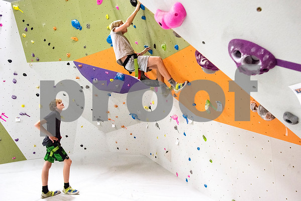 Dylan LeRoy, 14, watches as Ross Harris, 15, climbs at the Tyler Rock Gym in Tyler, Texas, on Wednesday, Nov. 29, 2017. The new gym features up to 32-foot high walls, 12 auto belays, youth programs, bouldering and classes for beginners and seasoned climbers alike. (Chelsea Purgahn/Tyler Morning Telegraph)