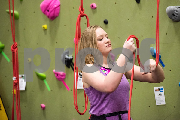 Alex Kotz prepares to climb at the Tyler Rock Gym in Tyler, Texas, on Wednesday, Nov. 29, 2017. The new gym features up to 32-foot high walls, 12 auto belays, youth programs, bouldering and classes for beginners and seasoned climbers alike. (Chelsea Purgahn/Tyler Morning Telegraph)