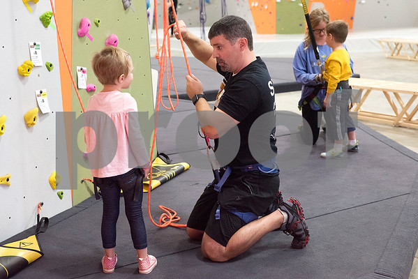 London Mather, 4, listens as Shawn Wilson gives her instructions at the Tyler Rock Gym in Tyler, Texas, on Wednesday, Nov. 29, 2017. The new gym features up to 32-foot high walls, 12 auto belays, youth programs, bouldering and classes for beginners and seasoned climbers alike. (Chelsea Purgahn/Tyler Morning Telegraph)