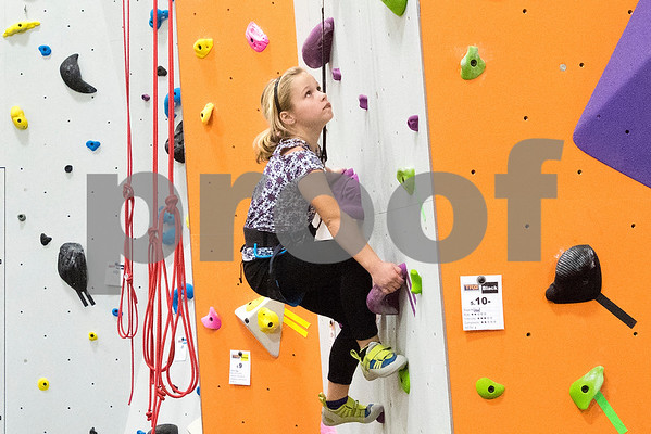 Kyndall Thurmon, 8, climbs at the Tyler Rock Gym in Tyler, Texas, on Wednesday, Nov. 29, 2017. The new gym features up to 32-foot high walls, 12 auto belays, youth programs, bouldering and classes for beginners and seasoned climbers alike. (Chelsea Purgahn/Tyler Morning Telegraph)