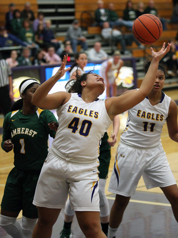 . Avon\'s Shaylynn Davidson reaches for a long rebound during the second quarter against Amherst. Randy Meyers -- The Morning Journal