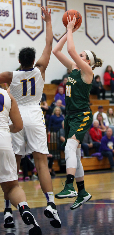. Kate lliff of Amherst shoots over Avon\'s Amari Davidson in the lane during the first quarter. Randy Meyers -- The Morning Journal
