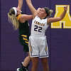 Avon's Juliann Walker blocks the shot by Kelsey Gonos of Amherst during the second quarter. Randy Meyers -- The Morning Journal