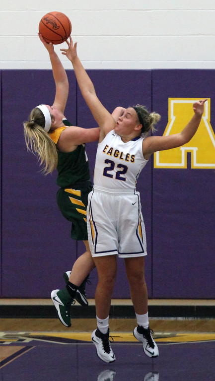 . Avon\'s Juliann Walker blocks the shot by Kelsey Gonos of Amherst during the second quarter. Randy Meyers -- The Morning Journal