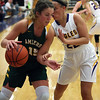 Sydney Roule of Amherst tries to drive by Juliann Walker of Avon during the first quarter. Randy Meyers -- The Morning Journal