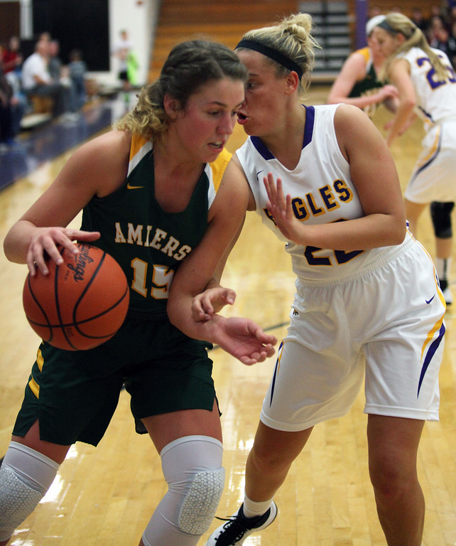 . Sydney Roule of Amherst tries to drive by Juliann Walker of Avon during the first quarter. Randy Meyers -- The Morning Journal