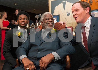 University of Houston quarterback Greg Ward, left, and current offensive coordinator and quarterbacks coach for Houston Major Applewhite, right, take a photo with Earl Campbell during the Earl Campbell Tyler Rose Award banquet Wednesday Jan. 13, 2016 at Willow Brook Country Club in Tyler, Texas. The Earl Campbell Tyler Rose Award recognizes the top offensive player in Division I football who also exhibits the enduring characteristics that define 1977 Heisman Trophy winner Earl Campbell: integrity, performance, teamwork, sportsmanship, drive, tenacity and community. Ward won the award.  (Sarah A. Miller/Tyler Morning Telegraph)