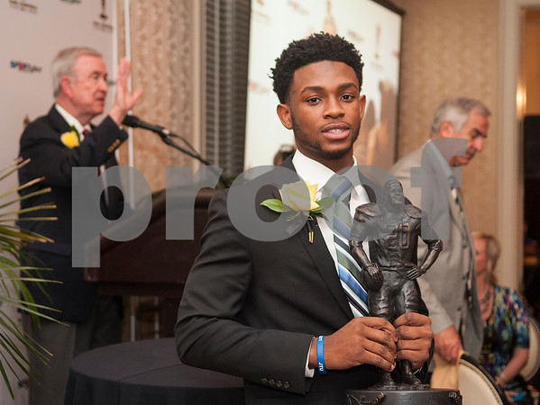 University of Houston quarterback Greg Ward holds his trophy after being named the winner of the Earl Campbell Tyler Rose Award Wednesday Jan. 13, 2016 at Willow Brook Country Club in Tyler, Texas. The Earl Campbell Tyler Rose Award recognizes the top offensive player in Division I football who also exhibits the enduring characteristics that define  1977 Heisman Trophy winner Earl Campbell: integrity, performance, teamwork, sportsmanship, drive, tenacity and community.  (Sarah A. Miller/Tyler Morning Telegraph)