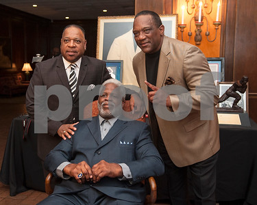 Cousin Ben Campbell, left, and fellow Heisman Trophy winner Billy Sims, right, take a photo with Earl Campbell during the Earl Campbell Tyler Rose Award banquet Wednesday Jan. 13, 2016 at Willow Brook Country Club in Tyler, Texas. The Earl Campbell Tyler Rose Award recognizes the top offensive player in Division I football who also exhibits the enduring characteristics that define 1977 Heisman Trophy winner Earl Campbell: integrity, performance, teamwork, sportsmanship, drive, tenacity and community.  (Sarah A. Miller/Tyler Morning Telegraph)