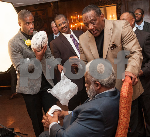 Fellow Heisman Trophy winner Billy Sims, right, talks with Earl Campbell during the Earl Campbell Tyler Rose Award banquet Wednesday Jan. 13, 2016 at Willow Brook Country Club in Tyler, Texas. The Earl Campbell Tyler Rose Award recognizes the top offensive player in Division I football who also exhibits the enduring characteristics that define 1977 Heisman Trophy winner Earl Campbell: integrity, performance, teamwork, sportsmanship, drive, tenacity and community.  (Sarah A. Miller/Tyler Morning Telegraph)