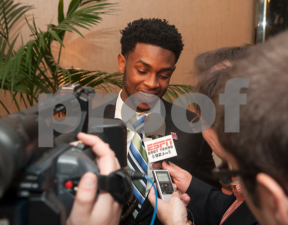 University of Houston quarterback Greg Ward is interviewed by various media outlets after being named the winner of the Earl Campbell Tyler Rose Award Wednesday Jan. 13, 2016 at Willow Brook Country Club in Tyler, Texas. The Earl Campbell Tyler Rose Award recognizes the top offensive player in Division I football who also exhibits the enduring characteristics that define  1977 Heisman Trophy winner Earl Campbell: integrity, performance, teamwork, sportsmanship, drive, tenacity and community.  (Sarah A. Miller/Tyler Morning Telegraph)