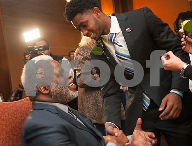University of Houston quarterback Greg Ward Jr. shakes hands with Earl Campbell during the Earl Campbell Tyler Rose Award banquet Wednesday Jan. 13, 2016 at Willow Brook Country Club in Tyler, Texas. The Earl Campbell Tyler Rose Award recognizes the top offensive player in Division I football who also exhibits the enduring characteristics that define 1977 Heisman Trophy winner Earl Campbell: integrity, performance, teamwork, sportsmanship, drive, tenacity and community. Ward won the award.  (Sarah A. Miller/Tyler Morning Telegraph)