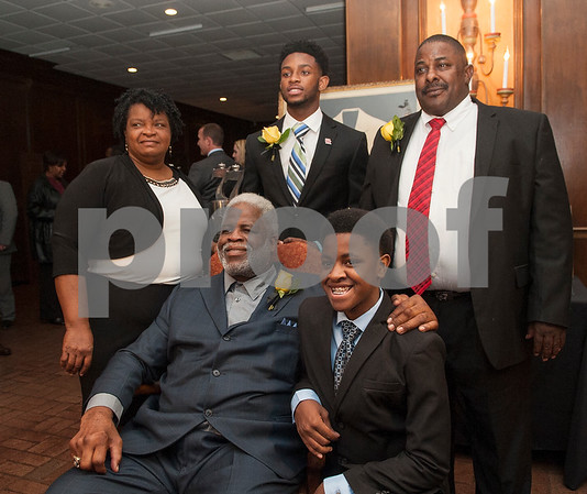 Earl Campbell takes a photo with Greg Ward Jr. and his family: Mary Ward, Jamariaon Ward, 14, and Greg Ward Sr. at the Earl Campbell Tyler Rose Award banquet Wednesday Jan. 13, 2016 at Willow Brook Country Club in Tyler, Texas. The Earl Campbell Tyler Rose Award recognizes the top offensive player in Division I football who also exhibits the enduring characteristics that define 1977 Heisman Trophy winner Earl Campbell: integrity, performance, teamwork, sportsmanship, drive, tenacity and community.   (Sarah A. Miller/Tyler Morning Telegraph)
