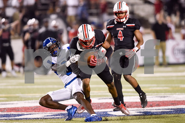 Robert E. Lee defensive back Marquis Gray (22) is tackled by North Mesquite wide receiver La'Maraye Brown (3) after Gray intercepted a pass intended for Brown during a high school football game at Christus Trinity Mother Frances Rose Stadium in Tyler, Texas, on Friday, Nov. 3, 2017. (Chelsea Purgahn/Tyler Morning Telegraph)