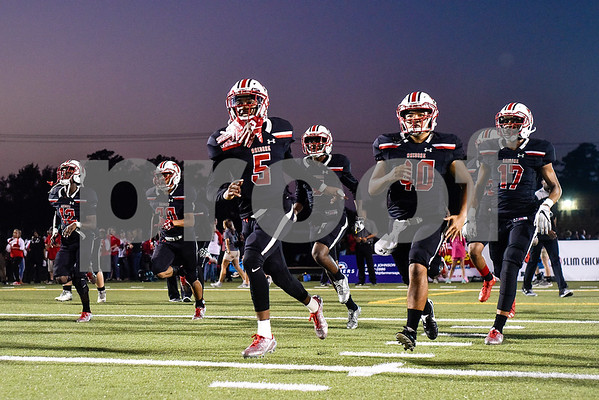Robert E. Lee players run onto the field for warmups during a high school football game at Christus Trinity Mother Frances Rose Stadium in Tyler, Texas, on Friday, Nov. 3, 2017. (Chelsea Purgahn/Tyler Morning Telegraph)