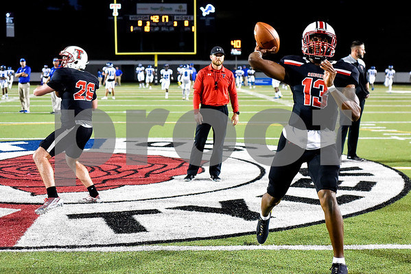 Robert E. Lee quarterbacks Roland Poster (26) and Chance Amie (13) warm up during a high school football game at Christus Trinity Mother Frances Rose Stadium in Tyler, Texas, on Friday, Nov. 3, 2017. (Chelsea Purgahn/Tyler Morning Telegraph)