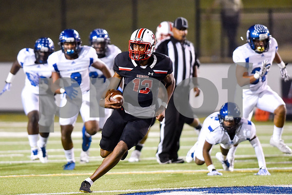 Robert E. Lee quarterback Chance Amie (13) runs the ball during a high school football game at Christus Trinity Mother Frances Rose Stadium in Tyler, Texas, on Friday, Nov. 3, 2017. (Chelsea Purgahn/Tyler Morning Telegraph)