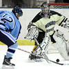 Monarch's Ian Oden (right) blocks a shot from Ralston Valley's Victor Lombardi (left) during their hockey game in Superior, Colorado January 14, 2013. BOULDER DAILY CAMERA/ Mark Leffingwell