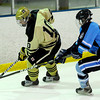 Monarch's Kevin Palm (left) keeps the puck from Ralston Valley's Tim Hunton (right) during their hockey game in Superior, Colorado January 14, 2013. BOULDER DAILY CAMERA/ Mark Leffingwell