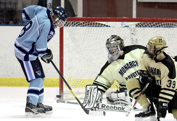 Monarch's Ian Oden (right) blocks a shot from Ralston Valley's Tanner West (left) during their hockey game in Superior, Colorado January 14, 2013. BOULDER DAILY CAMERA/ Mark Leffingwell