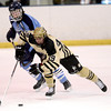 Monarch's Alex Barber (right) takes the puck past Ralston Valley's Greg Dyba (left) during their hockey game in Superior, Colorado January 14, 2013. BOULDER DAILY CAMERA/ Mark Leffingwell