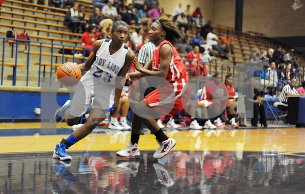 photo by Sarah A. Miller/Tyler Morning Telegraph  John Tyler's (23) Amia Wickware moves past Terrell's (3)Arnasia Henderson with the ball Monday night in Tyler.