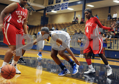 photo by Sarah A. Miller/Tyler Morning Telegraph  John Tyler's (23) Amia Wickware moves is fouled Monday night in the second period of their game at home against Terrell.