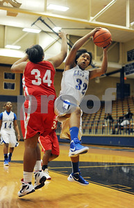 photo by Sarah A. Miller/Tyler Morning Telegraph  John Tyler's (32) Jasmine Hill grabs the rebound away from Terrell's (34) Jasmine Dean during the first period of their game in Tyler Monday night. John Tyler won, 83-46.