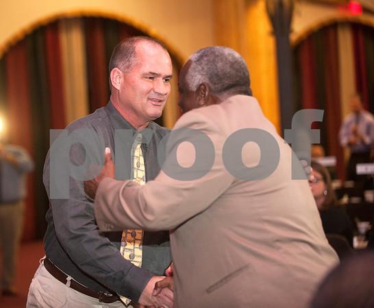 Mineral High School football coach Joe Drennon thanks Allen Wilson as he accepts the Allen Wilson Coach of the Year award at the American State Bank Player of the Year awards banquet Thursday Jan. 14, 2016 at KE Bushman's Celebration Center in Bullard.   (Sarah A. Miller/Tyler Morning Telegraph)