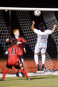 Robert E. Lee's Neri Ruiz (11) and Travis Vordenbaumen (7) try to defend the goal as John Tyler's Jarro Barrera (16) jumps and bumps the ball off his head into the goal during a high school soccer game at Robert E. Lee High School in Tyler, Texas, on Tuesday, Jan. 15, 2019. (Chelsea Purgahn/Tyler Morning Telegraph)
