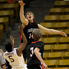 Fairview's Jacob Lorentzen (right) bats away the shot from Boulder's Demetrius Kennedy (left) during their basketball game the University of Colorado in Boulder, Colorado January 17, 2011. CAMERA/MARK LEFFINGWELL