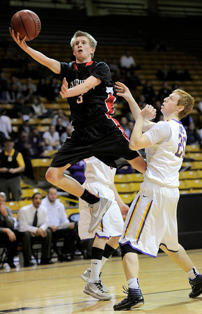 Fairview's Brent Wrap (left) takes a shot over Boulder's Alex King (right) during their basketball game the University of Colorado in Boulder, Colorado January 17, 2011. CAMERA/MARK LEFFINGWELL